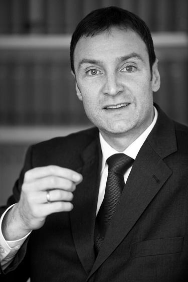Dr. Marius Breucker
